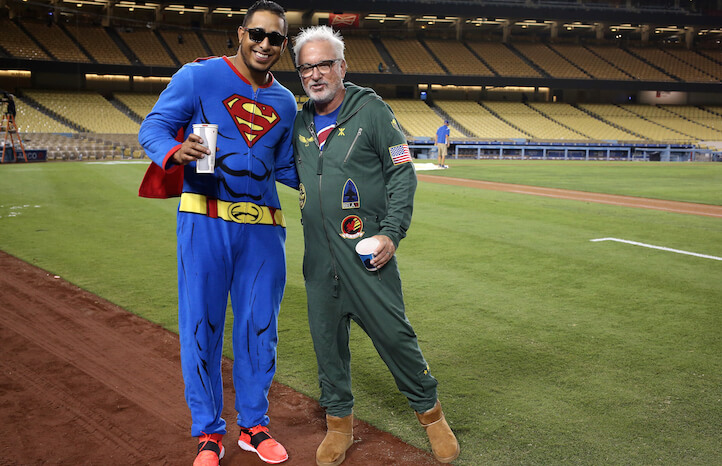 LOS ANGELES, CA - AUGUST 30:  Manager Joe Maddon (R) and pitcher Hector Rondon #56 of the Chicago Cubs pose for a photo as they wear pajamas as part of a team theme trip on their way out of town after the game against the Los Angeles Dodgers at Dodger Stadium on August 30, 2015 in Los Angeles, California.  The Cubs won 2-0.  (Photo by Stephen Dunn/Getty Images)