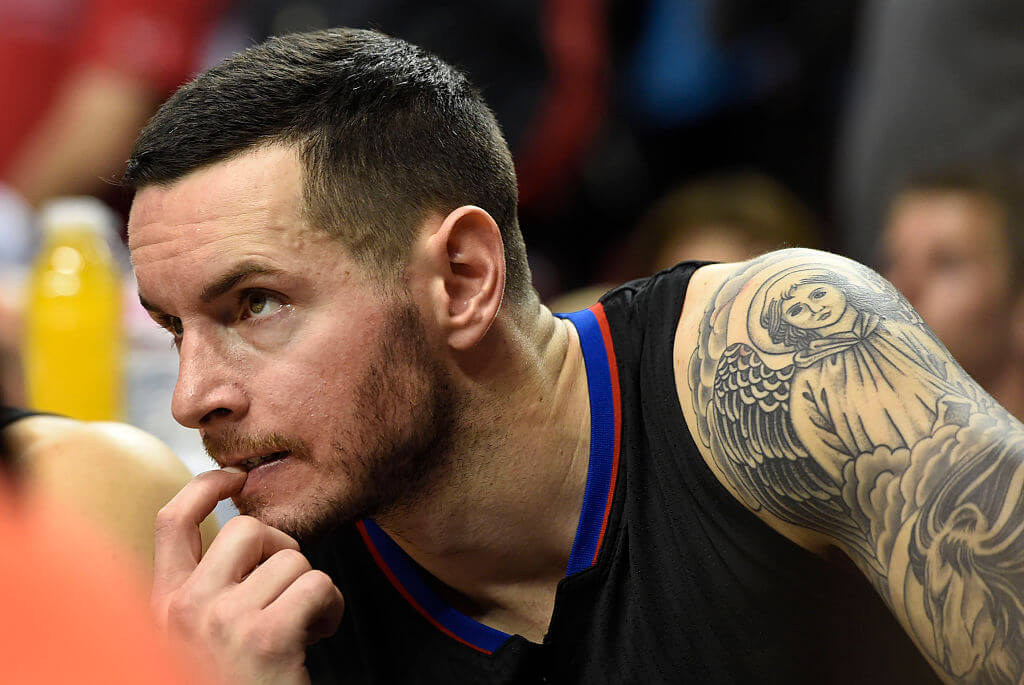 PORTLAND, OR - APRIL 25: J.J. Redick #4 of the Los Angeles Clippers sits on the bench as time winds down in the fourth quarter of Game Four of the Western Conference Quarterfinals against the Portland Trail Blazers during the 2016 NBA Playoffs at the Moda Center on April 25, 2016 in Portland, Oregon. The Blazers won the game 98-84. NOTE TO USER: User expressly acknowledges and agrees that by downloading and/or using this photograph, user is consenting to the terms and conditions of the Getty Images License Agreement. (Photo by Steve Dykes/Getty Images)