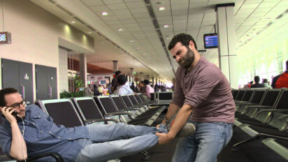 Airline Passenger Drags Man Out Of Airport Seat Near Outlet