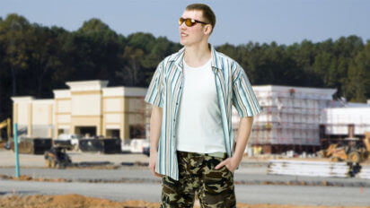 Man Wearing Oakleys And Camo Shorts Definitely Cuts His Own Hair